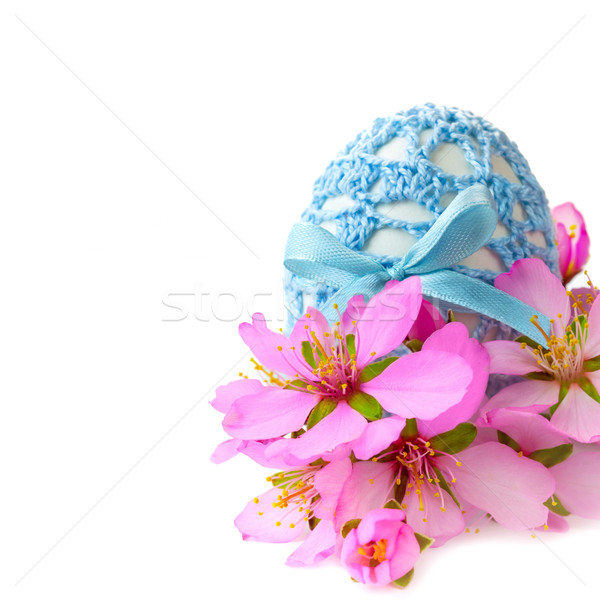 Easter egg in handmade decor with cherry flowers, isolated Stock photo © Taiga