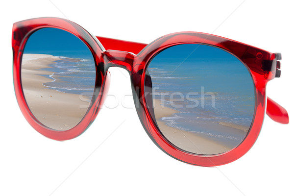 Summertime concept -  Sunglasses have a beach  reflecting on  is Stock photo © Taiga