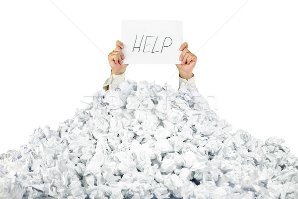 Person under crumpled pile of papers with a help sign / isolated Stock photo © Taiga