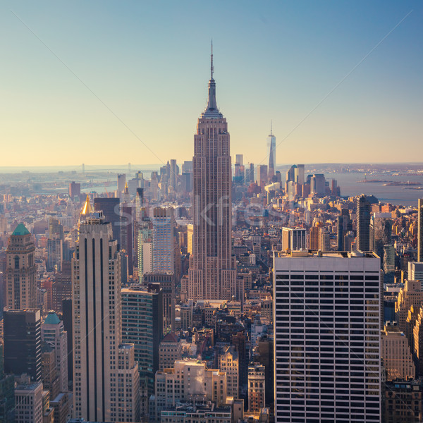 view of Manhattan skyline and skyscrapers at sunrise, New York C Stock photo © Taiga