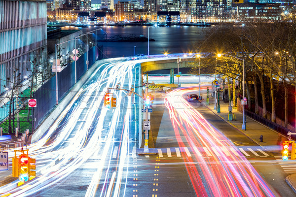 Light trails on the busy night streets, crossroad in big city Stock photo © Taiga