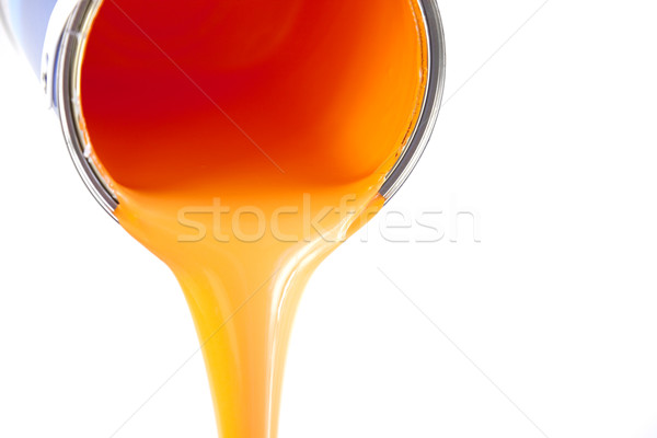 orange paint flows from the bucket / isolated on white / photo Stock photo © Taiga
