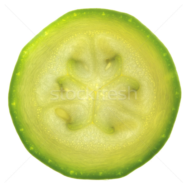Slice of zucchini or courgette isolated on white / back-lit Stock photo © Taiga