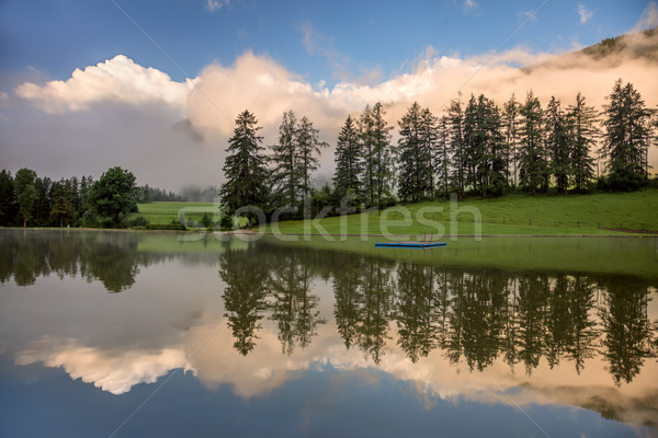 Foggy Morning on lake, with beautiful clouds and reflection Stock photo © Taiga