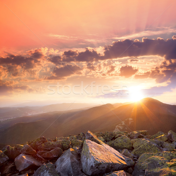 Sunset in the mountains landscape. Dramatic sky,  colorful stone Stock photo © Taiga