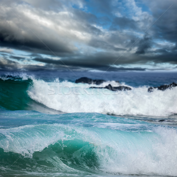 Dramatic dark clouds and big ocean waves Stock photo © Taiga