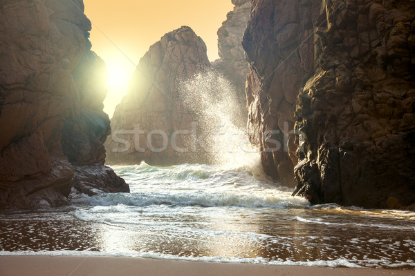 Fantastic big rocks and ocean waves at sundown time Stock photo © Taiga