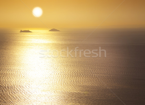 Sea / sunrise / silhouettes of the islands / space for your text Stock photo © Taiga