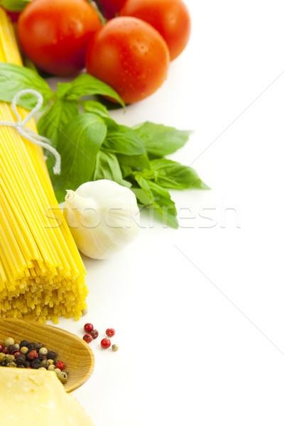 Stock photo: Ingredients for Italian cooking: basil, tomato, parmesan, garlic