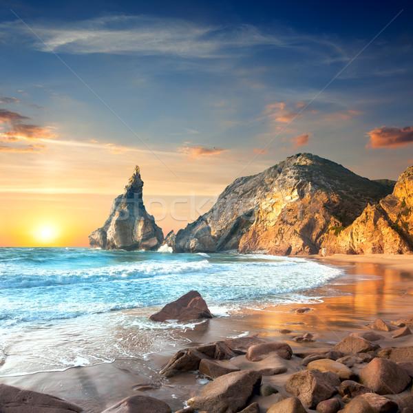 Océano paisaje puesta del sol tiempo hermosa rocas Foto stock © Taiga
