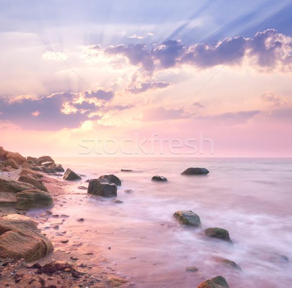 Dawn sunrise landscape over beautiful rocky coastline in the Sea Stock photo © Taiga