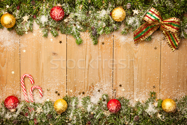 Christmas background with firtree, candies and baubles with snow Stock photo © Taiga