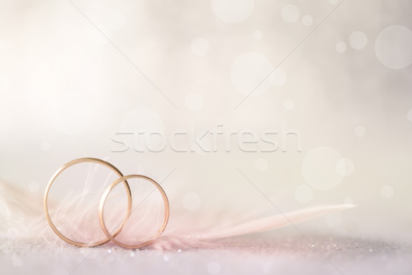 Two Golden Wedding Rings and Feather - light soft background Stock photo © Taiga