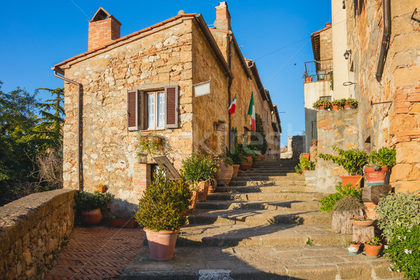 Stock photo: Tipical Old Italian town - narrow street with flowers