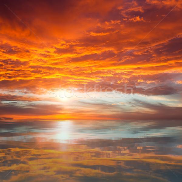 Reflectie mooie zonsondergang majestueus wolken zon Stockfoto © Taiga