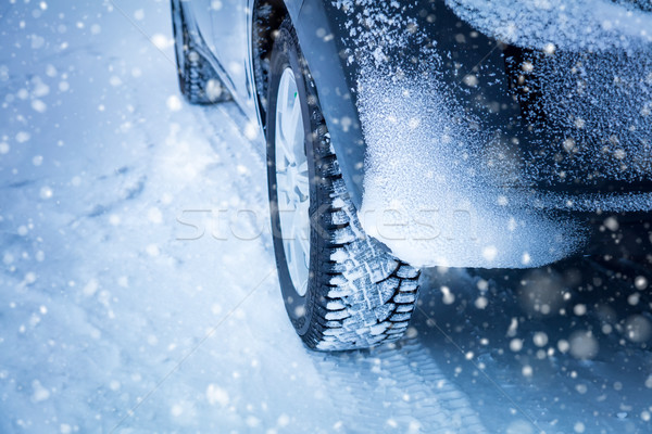 Driving in Winter -  Car's tyres and snowfall Stock photo © Taiga