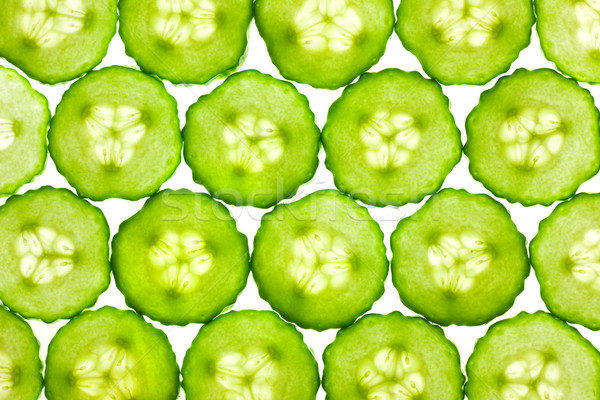 Slices of fresh Cucumber / background / back lit Stock photo © Taiga