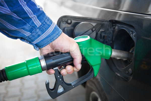 Hand Refilling the black Car with Fuel  Stock photo © Taiga