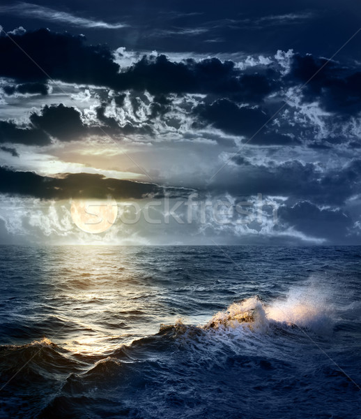 Stormy sea at Night with dramatic sky and the big Moon Stock photo © Taiga
