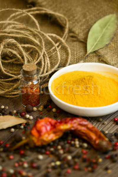 Turmeric in saucer with spices Stock photo © Taiga