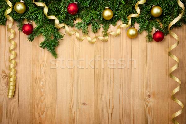 Christmas background with firtree, baubles and ribbons on wood Stock photo © Taiga