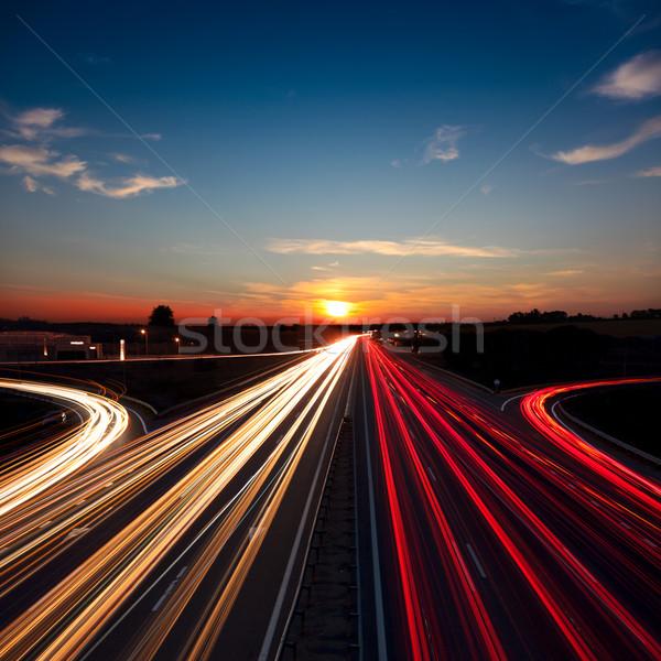 Velocidad tráfico la exposición a largo autopista carretera puesta del sol Foto stock © Taiga