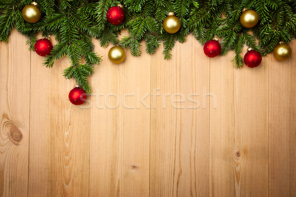 Christmas background with firtree and baubles on wood Stock photo © Taiga