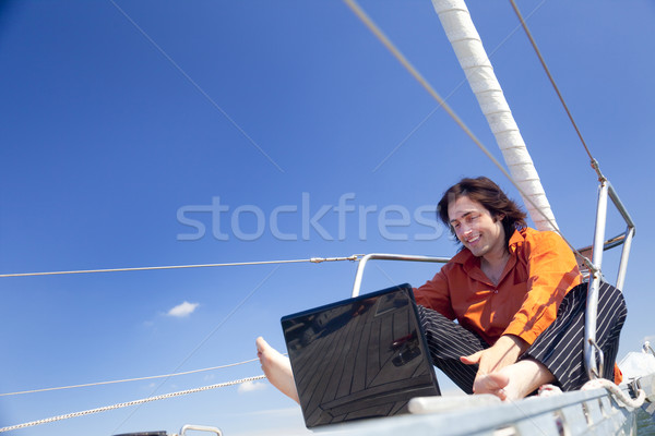 Zakenman laptop zeilboot laptop computer computer water Stockfoto © Taiga