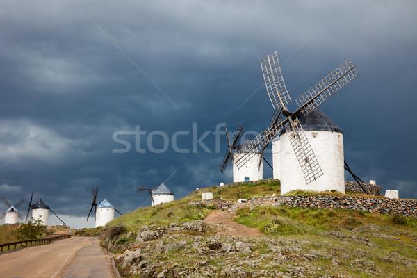 Old  windmills on dramatic sky and rainy weather Stock photo © Taiga