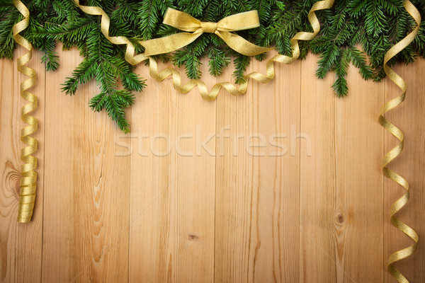 Christmas background with firtree, bow and ribbons on wood Stock photo © Taiga