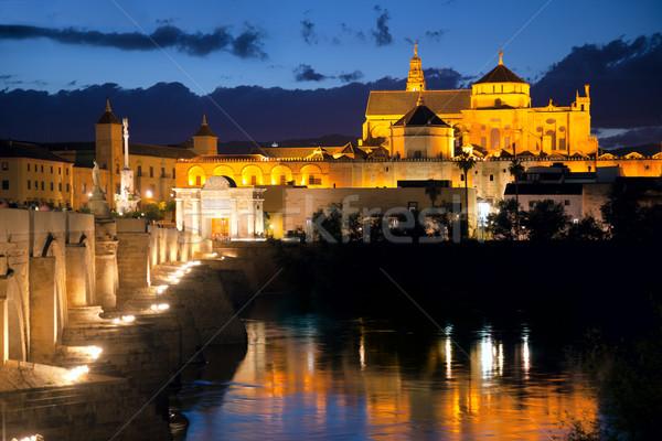Roman Bridge and Mosque (Mezquita)  at evening, Spain, Europe Stock photo © Taiga