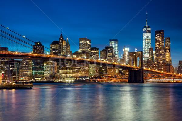 Manhattan felhőkarcolók híd este új New York Stock fotó © Taiga