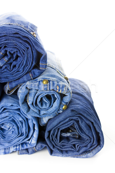 Rolls of Blue Jeans isolated on white background Stock photo © Taiga