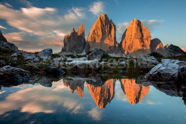 Tre Cime di Lavaredo with reflection in lake at sundown, Dolomit Stock photo © Taiga