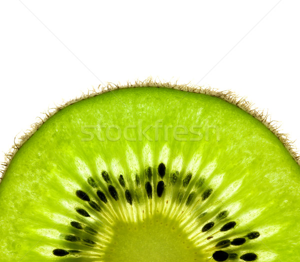Slice of a fresh Kiwi / Super Macro /  back lit Stock photo © Taiga