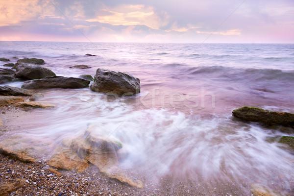 Színes napfelkelte tenger tengerpart folyik part Stock fotó © Taiga