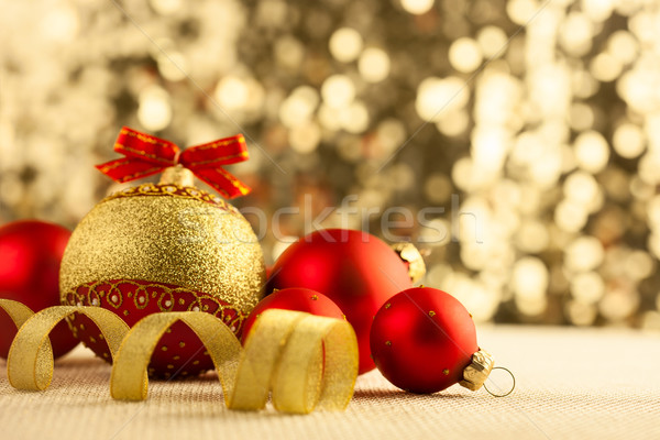 Christmas Bright red baubles with golden ribbons  Stock photo © Taiga