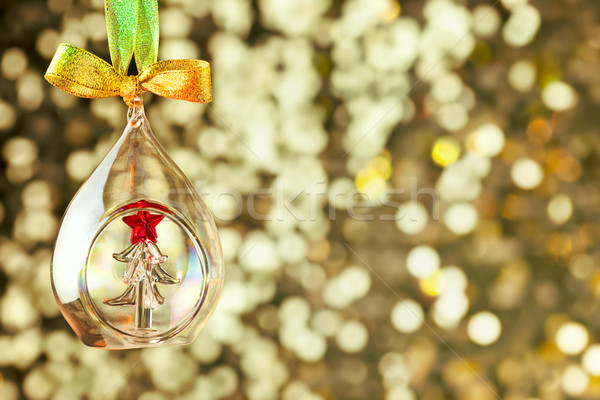 Christmas magic golden background with glass bauble and colorful Stock photo © Taiga
