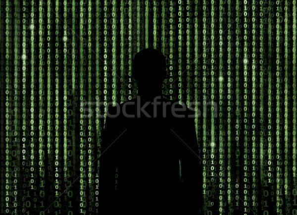 Silhouette of man looking through the matrix background Stock photo © Taiga