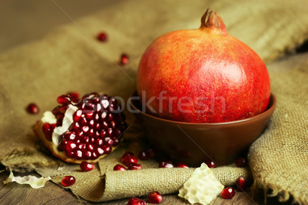 Ripe pomegranate in a bowl with seeds Stock photo © Taiga