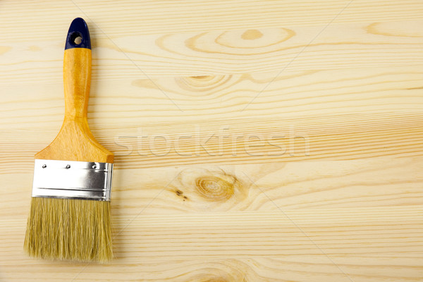 Wood and paintbrush / covering by varnish Stock photo © Taiga