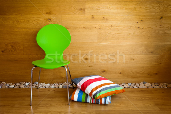 Green Chair and colorful pillows against wooden wall / Modern in Stock photo © Taiga