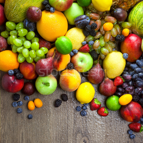 Stock photo: Organic Fruits  with water drops on dark wooden table