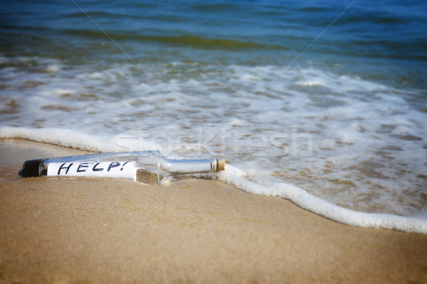 Message in a bottle / Help! Stock photo © Taiga