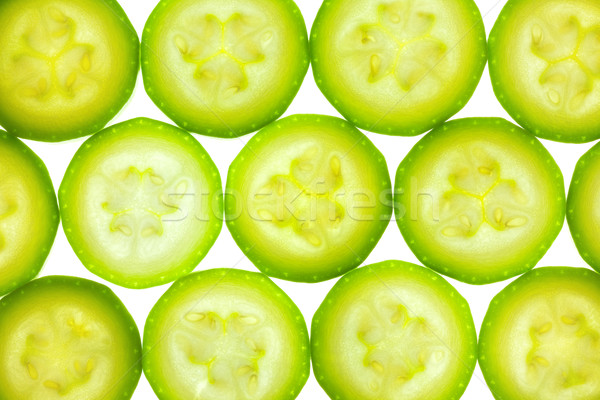 Slices of zucchini or courgette isolated on white / back lit Stock photo © Taiga