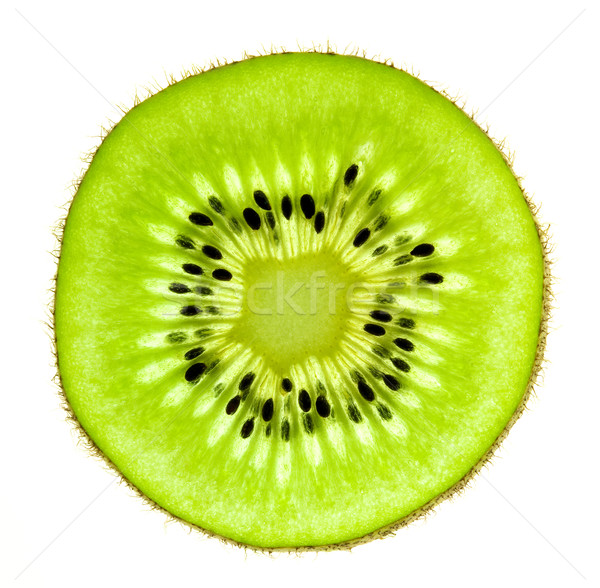 Slice of a fresh Kiwi / Super Macro /  back lit Stock photo © Taiga