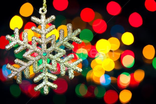Christmas decoration snowflake  on defocused lights background Stock photo © Taiga