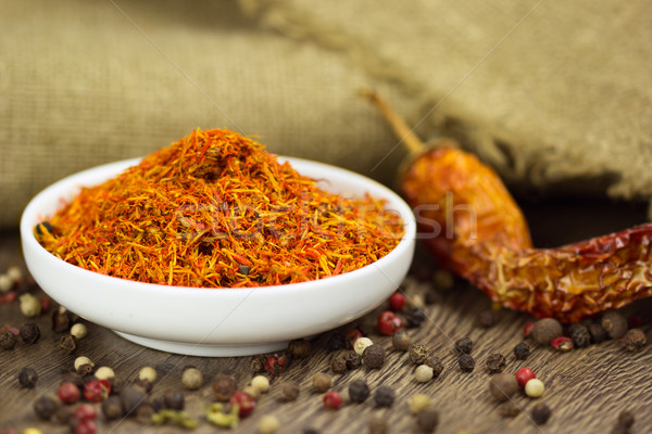 Saffron in saucer with pepper and chili Stock photo © Taiga