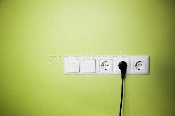 Electrical wall outlet / on green background Stock photo © Taiga
