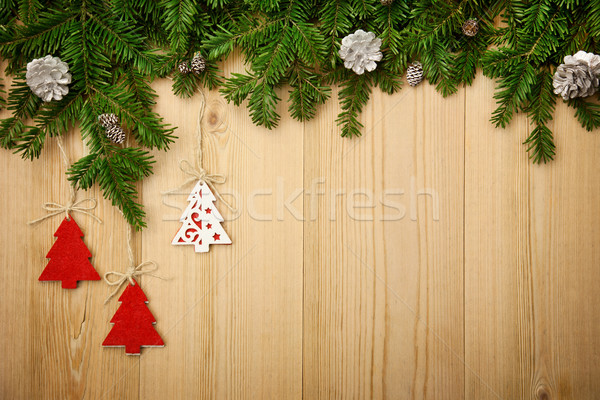 Christmas background with firtree, decorative trees and cones on Stock photo © Taiga